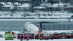 A Delta plane rests on a berm near the water at LaGuardia Airport. Delta Flight 1086, carrying 125 passengers and five crew members, veered off the runway at around 11:10 a.m., in New York, Thursday, March 5, 2015. Six people suffered non-life-threatening injuries. (AP / Craig Ruttle)