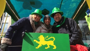 Caroline Van Vlaardingen, Cindy Sherwin and Paul Graif smile for a picture on the CTV Montreal St. Patrick's Day parade float.