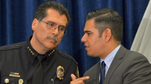 Long Beach Police Chief Robert Luna, left, confers with Mayor Robert Garcia after announcing the arrest of 4 people in connection with the death of 3-week-old Eliza De La Cruz in Long Beach, Calif., on Wednesday, March 25, 2015. Giseleangelique Rene D'Milian, Anthony McCall, Todd Goudreaux and Charisse Shelton were arrested in the kidnapping and death of De La Cruz on Janary 3, 2015. (AP Photo/The Daily Breeze, Scott Varley) MAGS OUT; NO SALES
