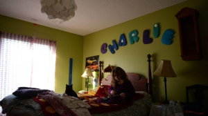 Charlie, age 9, who was born as a male but identifies as a female, is seen in her room at home in Ottawa on Wednesday, March 24, 2015. (Sean Kilpatrick / THE CANADIAN PRESS)