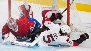 Ottawa Senators' Cody Ceci collides with Montreal Canadiens goaltender Carey Price during second period of Game 5 NHL first round playoff hockey action in Montreal, Friday, April 24, 2015. THE CANADIAN PRESS/Graham Hughes