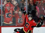 Calgary Flames Johnny Gaudreau celebrates his goal during second period NHL first round game six playoff hockey action against the Vancouver Canucks in Calgary, Saturday, April 25, 2015. (Jeff McIntosh / THE CANADIAN PRESS)