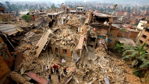 Rescue workers remove debris as they search for victims of earthquake in Bhaktapur near Kathmandu, Nepal, Sunday, April 26, 2015. (AP / Niranjan Shrestha)