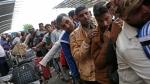Waiting in long lines at the Tribhuwan International Airport, on April 26, 2015. (AP / Wally Santana)
