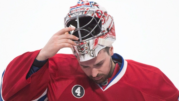 Montreal Canadiens goaltender Carey Price removes his helmet in a game against the Ottawa Senators in Montreal, on Friday, April 24, 2015. (THE CANADIAN PRESS/Graham Hughes)