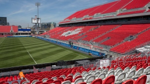 A worker fixes a seat at Toronto FC's BMO Field on Thursday, May 7, 2015. (The Canadian Press/Chris Young)