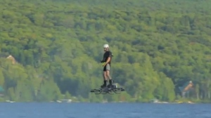 Catalin Alexandru Duru is seen setting a world record for longest flight on a hoverboard.