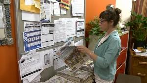 Publisher Lily Ryan with Pontiac Journal.