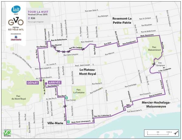 Cyclists ride through Montreal in Tour La Nuit and Tour de LIle