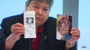 Widow Lise Blais holds up a photo of her deceased husband Jean-Yves, who was the symbolic head of one of the class action lawsuits. (CTV Montreal)