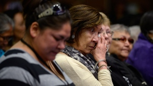 Residential school survivors and aboriginal women react as Truth and Reconciliation Commission chairman Justice Murray Sinclair speaks at the commission in Ottawa on Tuesday, June 2, 2015. (Adrian Wyld / THE CANADIAN PRESS)