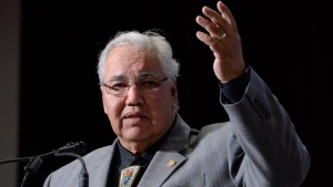 Commission chairman Justice Murray Sinclair raises his arm asking residential school survivors to stand at the Truth and Reconciliation Commission in Ottawa on Tuesday, June 2, 2015. (Adrian Wyld / THE CANADIAN PRESS)