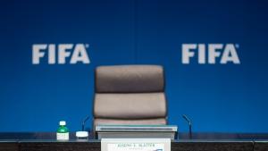 FIFA logos behind the empty chair of FIFA president Sepp Blatter in Zurich, Switzerland, on June 2, 2015. (Ennio Leanza / Keystone)