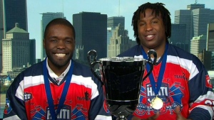 Georges Laraque and Ainslie Bien-Aime from the Haitian Ball Hockey Team saying winning the world championships is like a 'Cinderella story'