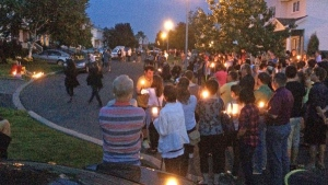 A vigil was held Saturday evening to honour the two young men who died in Boucherville.