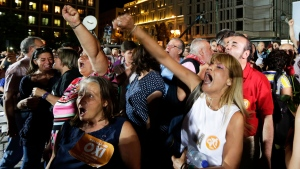 Supporters of the No vote react after the first results of the referendum at Klafthmonos square in Athens, Sunday, July 5, 2015.
