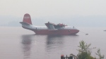 Despite no official deal in place with the B.C. government, one of the largest air water tankers in the world took a test dip in Sproat Lake near Port Hardy, B.C. to ready for action. July 7, 2015. (CTV Vancouver Island)