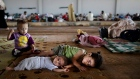 Syrian children who fled their home with their family due to fighting between the Syrian army and the rebels, lie on the ground while they and others take refuge at the Bab Al-Salameh border crossing, in hopes of entering one of the refugee camps in Turkey, near the Syrian town of Azaz, Aug. 26, 2012. (AP Photo / Muhammed Muheisen)