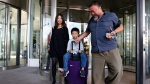 Chinese dissident artist Ai Weiwei, right, Wang Fen, left, and their son Ai Lao arrive at the airport in Munich, Germany, Thursday, July 30, 2015. (AP / Matthias Schrader)