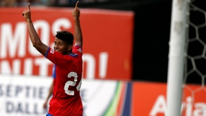Costa Rica midfielder Johan Venegas smiles as he looks over his shoulder after scoring a goal during the second half of a soccer match against Nicaragua at RFK Stadium, Wednesday, Sept. 3, 2014, in Washington. (AP Photo/Alex Brandon)