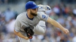 Kansas City Royals starting pitcher Danny Duffy watches a delivery during the first inning of a baseball game against the Detroit Tigers in Detroit on Aug. 4, 2015. (AP / Carlos Osorio)