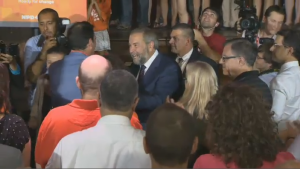 Tom Mulcair greets supporters on his way up to the podium at a rally in the Outremont riding Thursday, Sept. 3 2015.