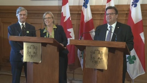Daniel Green, Elizabeth May and Denis Coderre at Montreal City Hall on Sept. 4, 2015