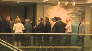 Some of the 34 defendants facing charges related to alleged corruption in the awarding of Laval municipal contracts and their lawyers file into a courtroom Friday, Sept. 4, 2015.