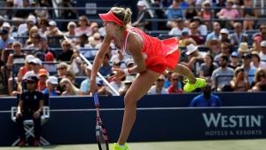 Eugenie Bouchard, of Canada, serves to Dominika Cibulkova, of Slovakia, during the third round of the U.S. Open tennis tournament, Friday, Sept. 4, 2015, in New York. (AP Photo/Charles Krupa)