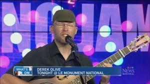 Folk singer Derek Olive stops at the Le Monument,