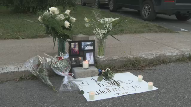 Family and friends set up a memorial for Jean-Housely St-Jean on the Laval street where he died Thursday. His ex-girlfriend has been charged in his death.