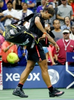 Rafael Nadal, of Spain, leaves the court after losing to Fabio Fognini, of Italy, during the U.S. Open tennis tournament in New York, Saturday, Sept. 5, 2015. (AP/Julio Cortez)