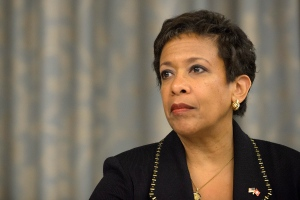Loretta Lynch, attorney general of the US attends a news conference on soccer related criminal proceedings, in Zurich, Switzerland, Monday, Sept. 14, 2015. Lynch says she expects more indictments in a widening investigation of corruption implicating FIFA. (Anthony Anex/Keystone via AP)