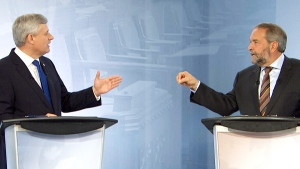 Conservative Leader Stephen Harper and NDP Leader Tom Mulcair speak during the French-language debate in Montreal on Thursday, Sept. 24, 2015.