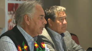 Ghislain Picard, chief of the Assembly of the First Nations of Quebec and Labrador, and Joe Norton, Kahnawake Grand Chief, speak at a news conference Oct. 2, 2015.