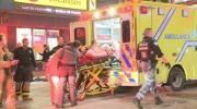 First responders put the victim of a downtown Montreal stabbing into an ambulance Sunday, Oct. 11 2015. A 19-year-old was seriously injured in the stabbing.