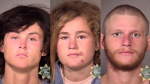 Multnomah County Sheriff's Office photos show the three suspects who were arrested October 7, 2015, in Portland, Ore., in the killings of Audrey Carey, a backpacker from Quebec who intended on traveling the United States and Europe, and Steve Carter, a tantra yoga teacher, on a hiking trail in Marin County, Calif. From left are Sean Michael Angold, 24; Lila Scott Allgood, 19; and Morrison Haze Lampley, 23. (THE CANADIAN PRESS/AP-HO, Multnomah County Sheriff's Office/Portland Police)