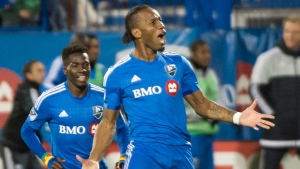 Montreal Impact's Didier Drogba celebrates after scoring against Toronto FC during second half MLS soccer action in Montreal, Sunday, October 25, 2015.  (Graham Hughes / THE CANADIAN PRESS)