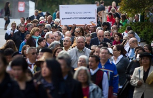 In this file photo, residential school survivors march to the opening ceremonies of the Truth and Reconciliation Commission of Canada British Columbia National Event in Vancouver, B.C., on Wednesday September 18, 2013. (Darryl Dyck/THE CANADIAN PRESS)