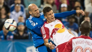 In this Aug. 5, 2015, file photo, Montreal Impact's Laurent Ciman, left, challenges New York Red Bulls' Matt Miazga during the second half of an MLS soccer game, in Montreal. (Graham Hughes/The Canadian Press via AP, File)