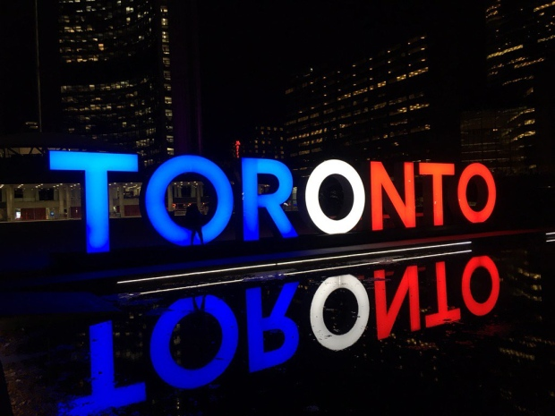 The 'Toronto' sign in Toronto's Nathan Phillips Square is lit up in support of France (Twitter/@JohnTory)