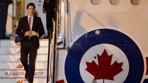 Canadian Prime Minister Justin Trudeau disembarks from his plane as he arrives for the Asia-Pacific Economic Cooperation (APEC) summit in Manila, Philippines, Tuesday, Nov. 17, 2015. (AP / Aaron Favila)