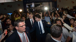 Canadian Prime Minister Justin Trudeau is greeted by hysterical crowds as he leaves his closing press conference following the APEC Summit in Manila, Philippines on Thursday, November 19, 2015. THE CANADIAN PRESS/Sean Kilpatrick