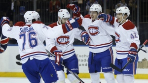 Montreal Canadiens right wing Sven Andrighetto (42) celebrates with teammates after scoring a goal against the New York Rangers during the first period of an NHL hockey game, Wednesday, Nov. 25, 2015, in New York. (AP Photo/Julie Jacobson)