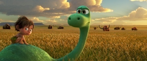 This image released by Pixar-Disney shows Spot, voiced by Jack Bright, left, and Arlo, voiced by Raymond Ochoa, in a scene from 'The Good Dinosaur.' (Pixar-Disney via AP)