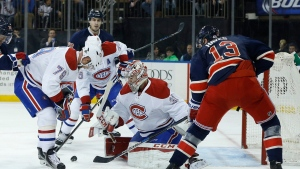 Montreal Canadiens goalie Carey Price (31) makes a save on a shot by New York Rangers right wing Kevin Hayes (13) as Canadiens defenceman Andrei Markov (79) looks for the rebound during the second period of an NHL hockey game, Wednesday, Nov. 25, 2015, in New York. The Canadiens won 5-1. (AP Photo/Julie Jacobson)