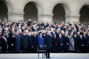French President Francois Hollande, centre, attends a ceremony to honor the 130 victims killed in the Nov. 13 attacks in the courtyard of the Invalides in Paris, Friday, Nov. 27, 2015. (Philippe Wojazer/Pool Photo via AP)
