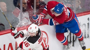 Montreal Canadiens' Nathan Beaulieu (28) collides with New Jersey Devils' Jacob Josefson during second period NHL hockey action, in Montreal, on Saturday, Nov. 28, 2015. THE CANADIAN PRESS/Graham Hughes