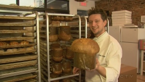Mirko D'Agata, head baker at Montreal bakery Arte e Farina, holds up one of his panettones.