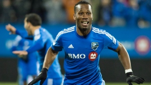 Montreal Impact's Didier Drogba celebrates after scoring against Toronto FC during first half MLS playoff soccer action in Montreal, Thursday, October 29, 2015. (Graham Hughes / THE CANADIAN PRESS)